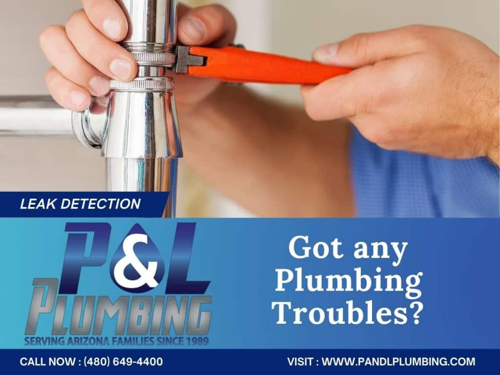 man with a tool fixing a faucet Water Filtration